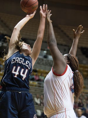 Montgomery Academy's Caroline Kirkham (44) shoots over Midfield's Amaya Fluker (34) during the AHSAA Class 3A Central Regional Championship on Thursday, Feb. 19, 2015, at the Dunn-Oliver Acadome in Montgomery, Ala.