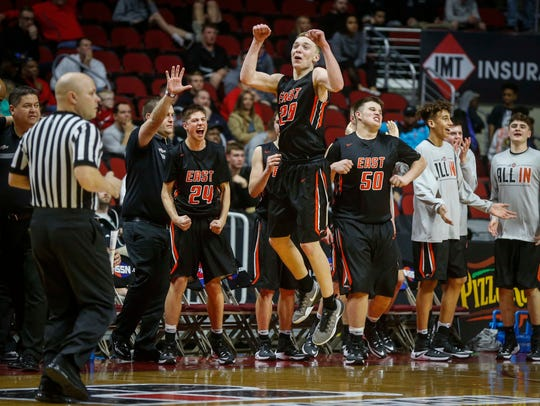Members of the Sioux City East basketball team celebrate