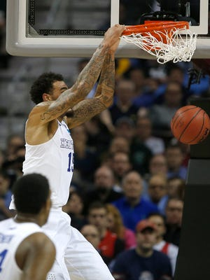 Kentucky forward Willie Cauley-Stein dunks during the first half of the Wildcats' win in Cleveland on Thursday night.
