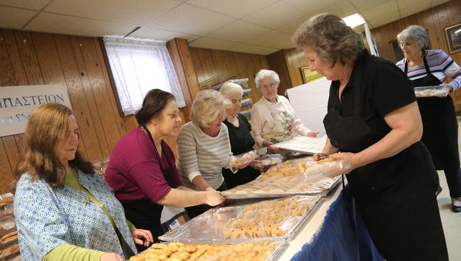 Volunteers at Sts. Constantine and Helen Greek Orthodox church prepare desert trays for their annual Greek Festival which will take place on May 18-20.