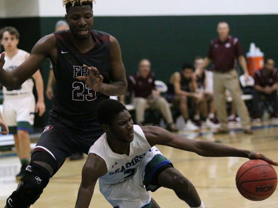 Stingrays senior Peter Charles (3) tries to maintain possession during the Class 3A-District 6 matchup between First Baptist Academy and Seacrest Country Day on Tuesday.