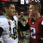 Titans quarterback Marcus Mariota, wearing a lei, chats with Falcons quarterback Matt Ryan after a preseason game last month.
