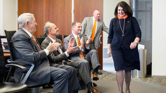 Beverly Davenport is applauded on Thursday, Dec. 15, 2016, in Nashville, Tenn., after the University of Tennessee Board of Trustees voted to approve her appointment as chancellor of the state's flagship public school in Knoxville.