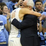 PHILADELPHIA, PA - MARCH 27: The North Carolina Tar Heels celebrate by hoisting the trophy after defeating the Notre Dame Fighting Irish with a score of 74 to 88 in the 2016 NCAA Men's Basketball Tournament East Regional Final at Wells Fargo Center on March 27, 2016 in Philadelphia, Pennsylvania.