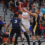 Clyde's Zach Rieman loses his footing during the first half of a basketball game against Norwalk on Wednesday, Mar 5, 2014.