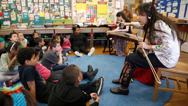Lan Tung of the Orchid Ensemble instructs students at Milwaukee's Trowbridge School through the Milwaukee Symphony's Arts in Education program. During the past decade, the Milwaukee Symphony has used most of its National Endowment for the Arts funds for school programs.