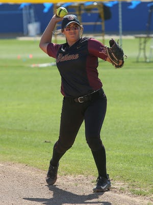La Quinta High School graduate Mariah Estrada warms up for Bethune-Cookman in the Mary Nutter Collegiate Softball Classic in Cathedral City, before a game against LSU.