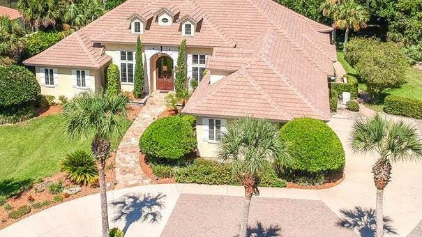 This house in Island Estates was built in 2004 on a saltwater canal in Hammock Dunes and sold recently for $907,300. It has four bedrooms and 5 1/2 baths in 3,628 square feet of living space. It also has a home office, a screened pool and spa, a fireplace, custom kitchen cabinets and a kitchen island plus a butler's pantry. It sits on almost an acre of land.
