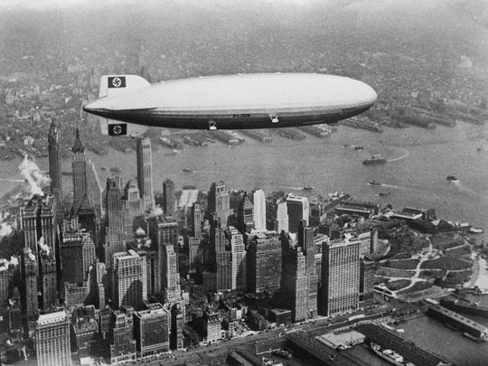 The German passenger Zeppelin Hindenburg photographed over Lower Manhattan in the late 1930s.