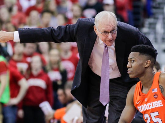 Syracuse coach Jim Boeheim talks with Tyus Battle (25) during the first half of the team's NCAA college basketball game against Wisconsin on Tuesday, Nov. 29, 2016, in Madison, Wis. (AP Photo/Andy Manis)