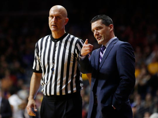 Northern Iowa head coach Ben Jacobson talks with an official between plays Saturday, Dec. 17, 2016, during their game in the Hyvee Classic at Wells Fargo Arena in Des Moines.
