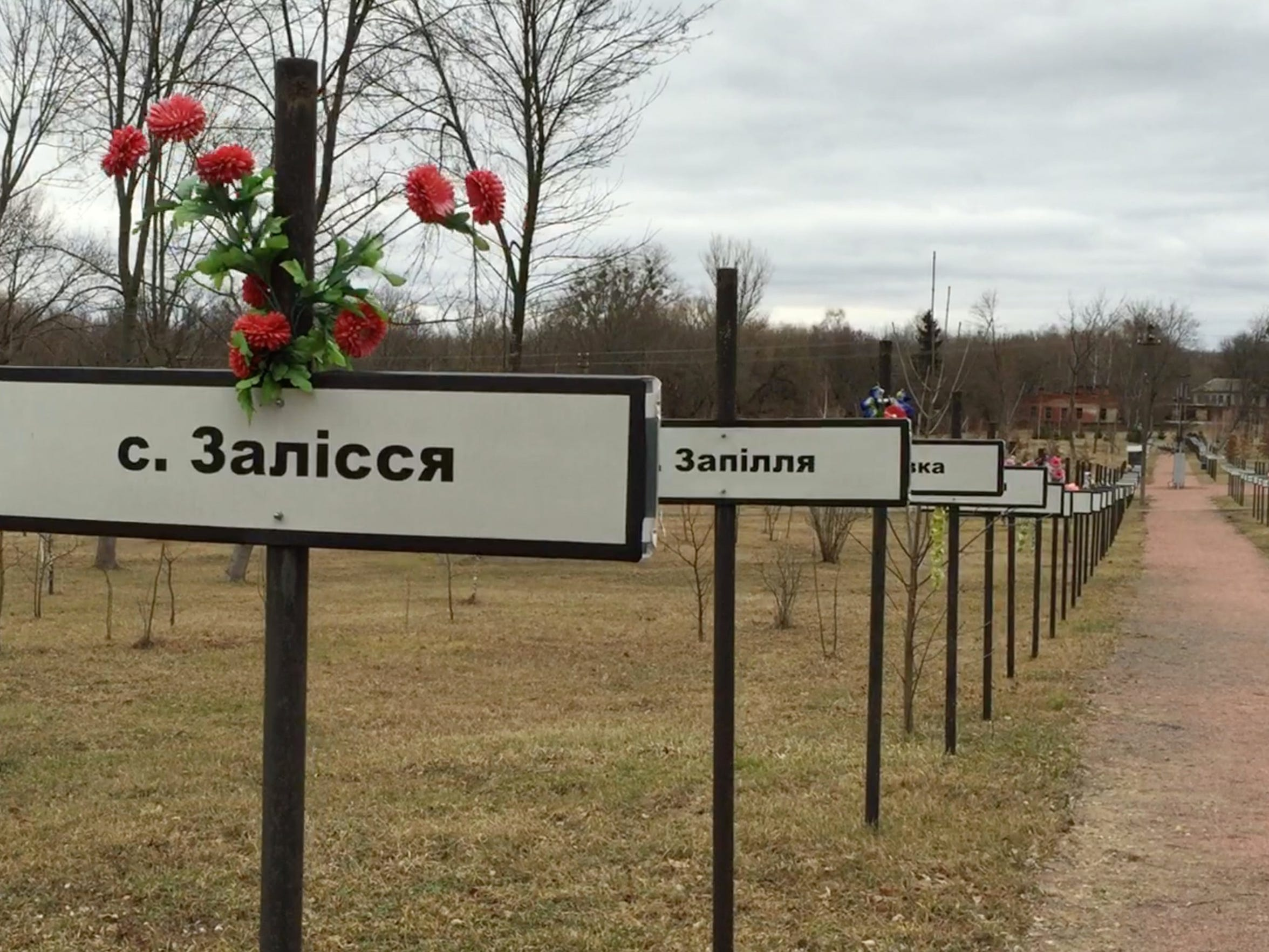 Memorials for villages in Ukraine that were abandoned because of the nuclear disaster.