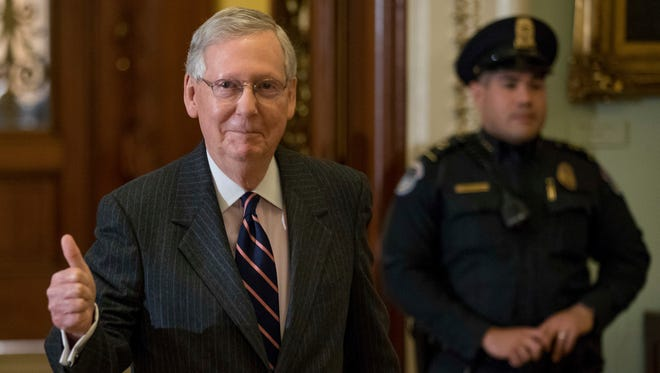 Senate Majority Leader Mitch McConnell of Ky. gives members of the media a thumbs up as he leaves the Senate chamber on Capitol Hill in Washington, Tuesday, Feb. 7, 2017, after the Senate confirmed Betsy DeVos as education secretary, with Vice President Mike Pence breaking a 50-50 tie. (AP Photo/Andrew Harnik)