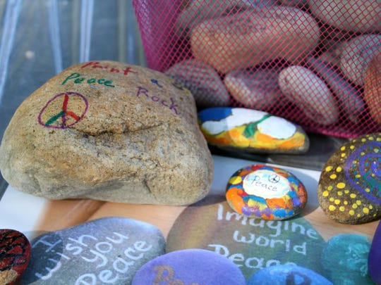 People decorated Asheville peace rocks Saturday in honor of International Peace Day, which is Sept. 21 each year. Peace rocks are used to spread messages of peace around the world. People paint words, images, and messages of peace, love, hope, and joy on the rocks.