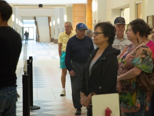 Doña Ana residents, wait in line at the Doña Ana County