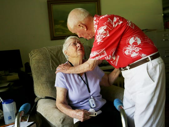 Paul Smith, 95, comforts his wife, Viola, 94, in their East Naples home on Monday, Oct. 17, 2016, as he recalls serving during the Pearl Harbor attack.