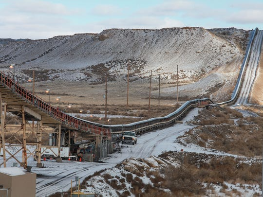 A long conveyor belt delivers coal from a nearby mine to PacifiCorp's Jim Bridger coal plant in southwestern Wyoming on Dec. 7, 2016.