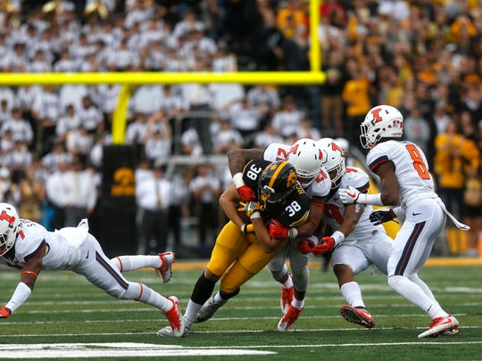 Iowa tight end T.J. Hockenson fights for extra yards