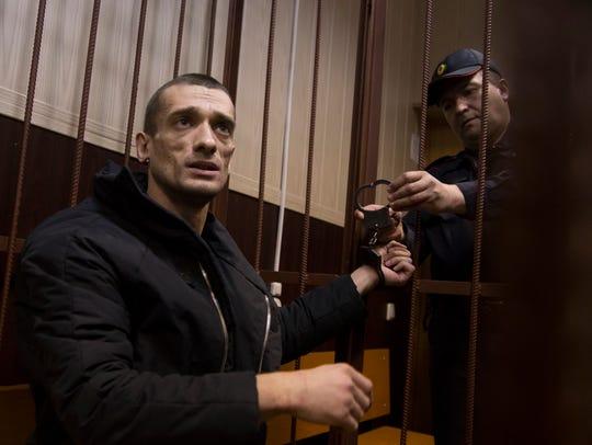 Russian artist Petr Pavlensky speaks to journalists