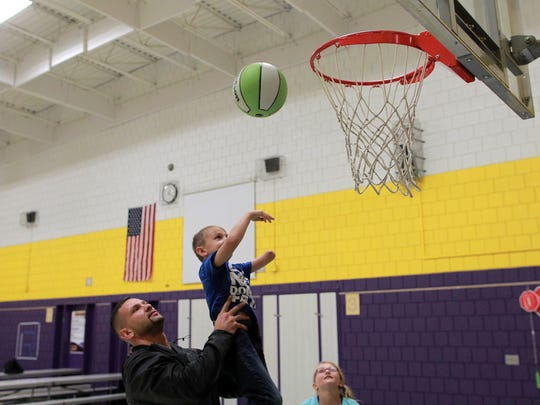 Jayce Crowder, 6, plays basketball with his dad, Ben, and sister, Allyssa, 10, at Pleasant Hill Elementary in Pleasant Hill on Friday, Oct. 27, 2017.