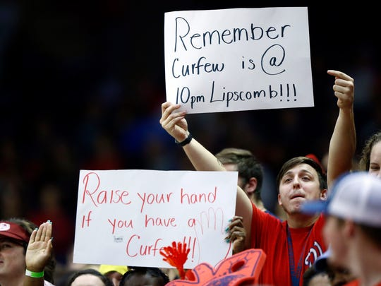 Belmont fans hold up signs during their game against Lipscomb, Monday, Nov. 27, 2017, in Nashville, Tenn.
