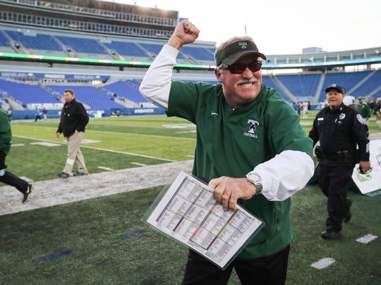 Trinity football coach Bob Beatty pumps his fist toward the crowd following his victory over St. Xavier in the Commonwealth Gridiron Bowl held at the UK football stadium on Sunday afternoon. Dec. 3, 2017