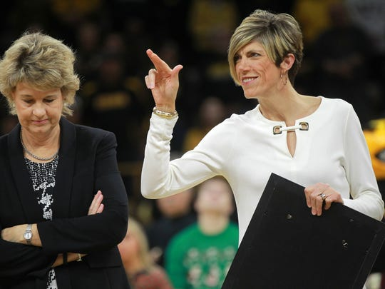 Iowa associate head coach Jan Jensen is recognized for entering the Des Moines Register Hall of Fame before the Hawkeyes' game against Drake at Carver-Hawkeye Arena on Thursday, Dec. 21, 2017.