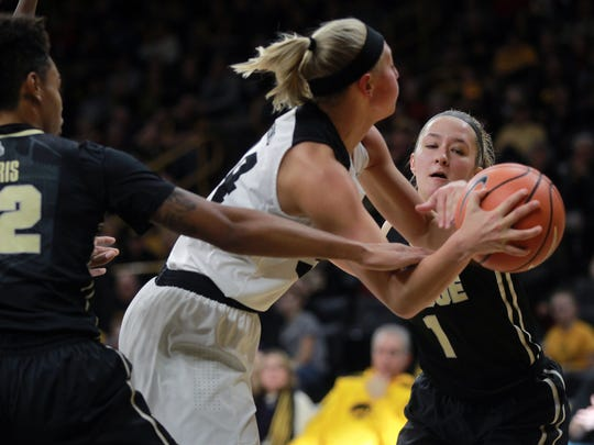 Iowa's Carly Mohns draws a foul from Purdue's Karissa McLaughlin during their game at Carver-Hawkeye Arena on Saturday, Jan. 13, 2018.