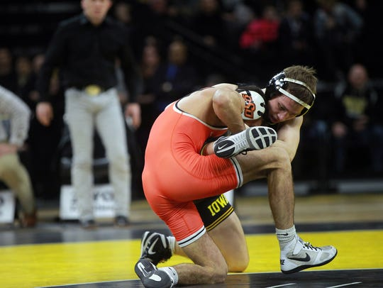 Iowa's Spencer Lee wrestles Oklahoma State's Nick Piccininni