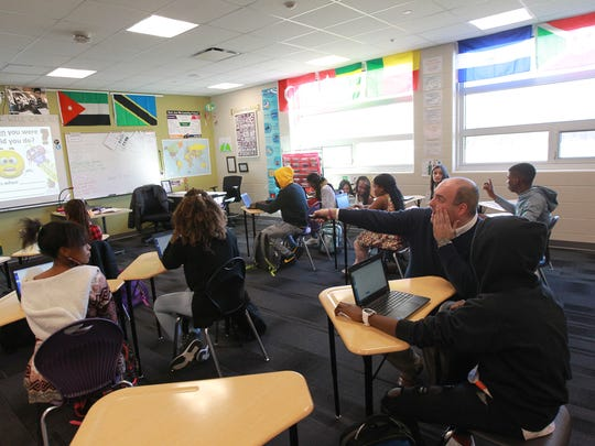 Daniel Lekin helps a student in his ELL class at Liberty
