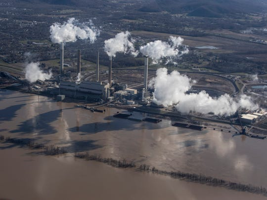 Steam billows from the Mill Creek Power Station in southwest Jefferson County as the swollen waters of the Ohio River encroach on the facility. Feb. 26, 2018