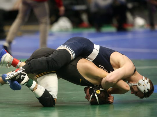 Penn State's Jason Nolf, top, is going for his third NCAA wrestling championship this week in Pittsburgh.