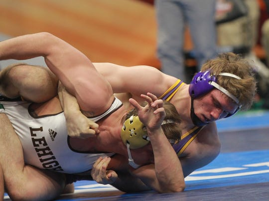UNI's Jacob Holschlag wrestles Lehigh's Chris Weiler at 197 pounds at the NCAA Wrestling Championships at Quicken Loans Arena in Cleveland, Ohio on Friday, March 16, 2018. Holschlag won by decision, 3-2.