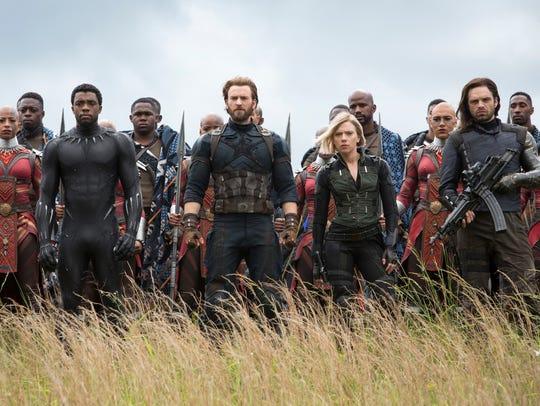 Black Panther (Chadwick Boseman, front left), Captain