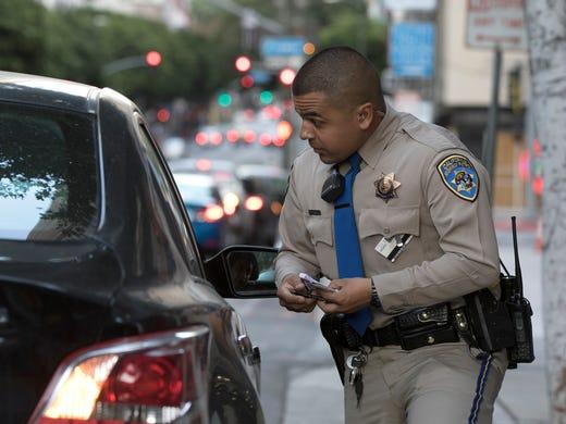 Highway Patrol Officer Benjamin Gomez speaks with a