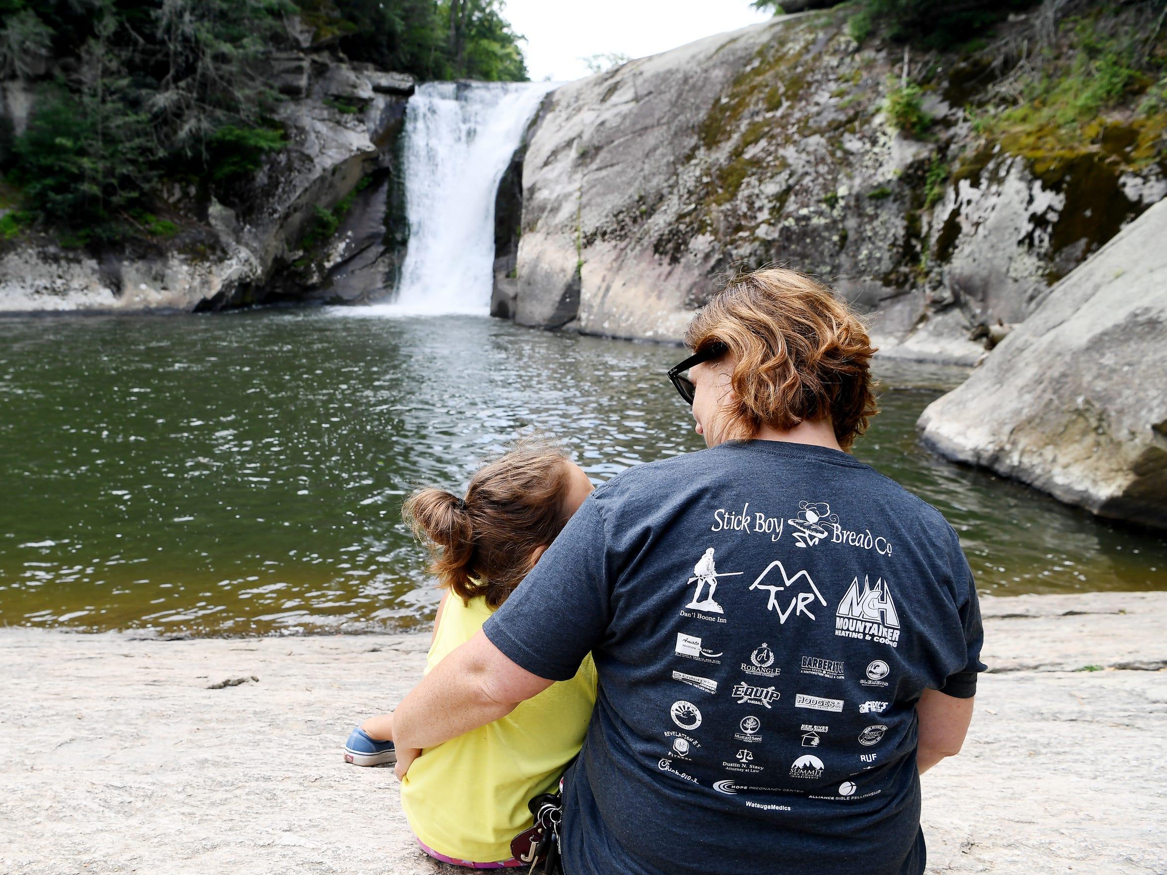 Dell Lowe and her daughter, Ali, 8, enjoy Elk River Falls July 20, 2018.