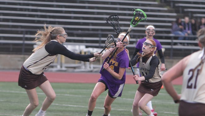 Action during a Section 1 girls lacrosse game between Clarkstown South and Clarkstown North at Clarkstown South High School Wednesday, May 4th, 2016. Clarkstown North won 13-12.