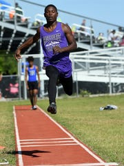 George Allen of Space Coast soars above the jumping pit at Merritt Island High.