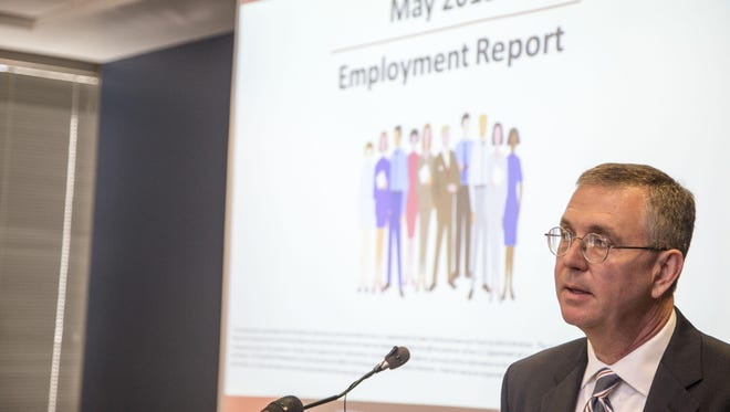 Paul Shannon, the state's assistant director for budget and planning resources, leads the state's regular jobs briefing on June 18, 2015 at the Department of Administration Building in Phoenix, Az.
