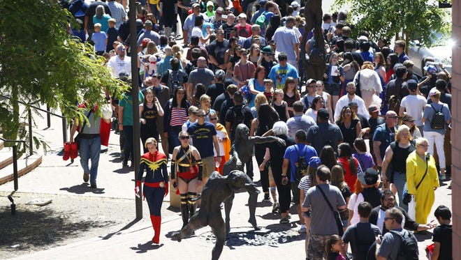 Long lines wrap around the block at Phoenix Comicon on May 26, 2017, at the Phoenix Convention Center. New security measures were implemented after an armed man was arrested at the event the previous day.