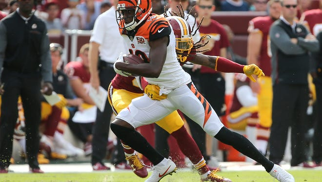 Cincinnati Bengals wide receiver A.J. Green (18) avoids a tackle after making a catch in the first quarter during the Week 3 NFL preseason game between the Cincinnati Bengals and Washington, Sunday, Aug. 27, 2017, at FedEx Field in Landover, Maryland.
