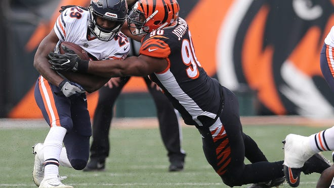 Cincinnati Bengals defensive end Michael Johnson (90) tackled Chicago Bears running back Tarik Cohen (29) during the Week 14 NFL game between the Chicago Bears and the Cincinnati Bengals, Sunday, Dec. 10, 2017, at Paul Brown Stadium in Cincinnati. Chicago won 33-7.