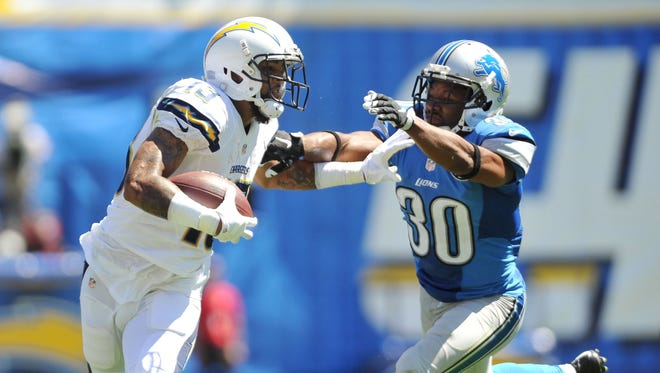 San Diego Chargers wide receiver Keenan Allen stiff-arms Detroit Lions defensive back Josh Wilson, right, after a reception.