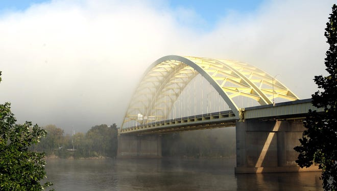 Morning fog shrouds the Ohio side of the Daniel Carter Beard Bridge, also known as the Big Mac. A reader suggests a similar bridge replace the Brent Spence Bridge.
