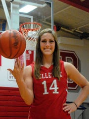 Bellevue graduate Carly Santoro, whose rewrote Lady Red record books throughout her basketball career, is the News-Messenger's Michael Bosi Athlete of the Year Award winner.
