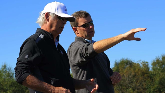 Renowned golf architect Gil Hanse (right) makes a point to George Bryan during the early stages of the design of Mossy Oak Golf Club.