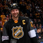 John Scott poses with the MVP trophy after the 2016 Honda NHL All-Star Final Game between the Eastern Conference and the Western Conference at Bridgestone Arena on January 31, 2016 in Nashville.