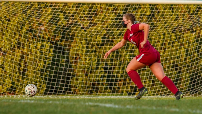 Bishop Stang junior Lily Shields runs down the sidelines uncontested.