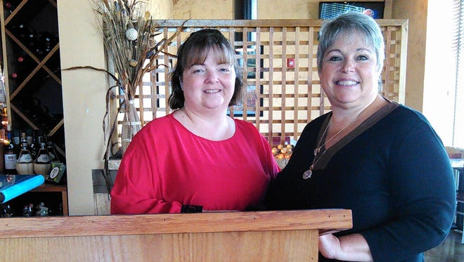 Danielle Tiegen (left) is area manager for Zio Johno's and Lori Meyer is a trustee of the North Liberty Community Fund. A portion of the restaurant's proceeds on Monday will be donated to the fund.