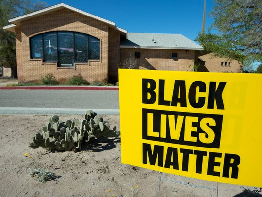 """Newly installed """"Black Lives Matter"""" signs are posted"""